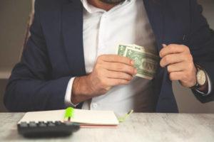 man hand money on pocket in office